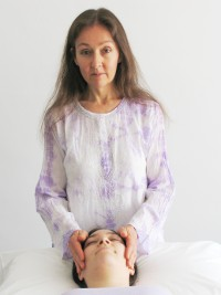 A gentle laying on of the hands allows the healing Reiki energy to flow where it is needed.